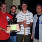 2011 Greenwood Bums champ, Marty Nelson shows off the Armchair Ace fantasy baseball trophy.