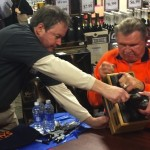 Mike Ditka signs The Throwback