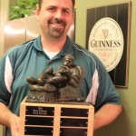 "2011 Fantasy Baseball Champion Dan Nelson holds the ""He Man Women Haters Club"" trophy"