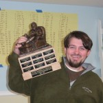 2008 GUNK Fantasy Baseball League champ, Hoyos- hoists the championship trophy.