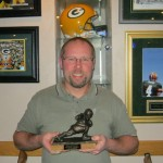 """Bubba's Bombers"" team owner & 2011 champion, Brian Dollevoet holds the coveted ""Baisch Trophy""."