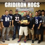 The Gridiron Hogs with The Throwback fantasy football trophy.