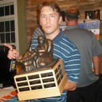 Fantasy football league champ Jim T. with the trophy