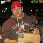 2011 Superior Plastics Super League fantasy football champ Joe Skriletz with the Throwback trophy.