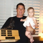 2011 champ, Jonathan Bauman, holds his daughter and his league's Muni trophy.  Life is good.