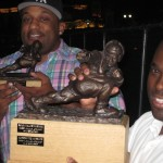 Kenneth and Mishone of L.E.A.G. show off the league's hardware.