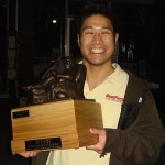 2010 Champ Matt Lim holds the Webb Fantasy Football Trophy.