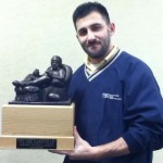 "Necati Aksoy holds the ""We Are Nashville"" fantasy football trophy."