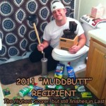"Scalzy, the 2011 ""Muddbuttt"" recipient with the Ultimate Loser fantasy football trophy"