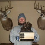 "Back to back champion Joe Banek with ""THE IRON MIKE"" and his two record bucks. (this photo is the winner of our first ever Wall of Fame photo contest.  Joe's league won an Armchair QB Mini)"
