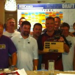 Brian Goff hoists the trophy as the champion of the KINGSPORT KINGS Fantasy Football League - Maryland