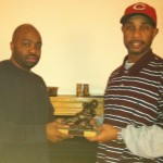 League commissioner Al Elvin (left) presenting the 2011 DAFFL Championship  trophy to Cornell Qualls (right).
