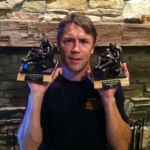 2-time fantasy football champion, Jim T., holds both of his Armchair Quarterback trophies.