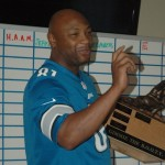 "2011 Champion &  owner of ""Big Black Johnson"", Jelani Wiggins holds the ""Gimmie the B.O.O.T.Y."" trophy."