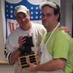 "Da Commish hands the Dave ""Wanny"" Wannstedt Ultimate Loser trophy to Mike Chernoff of the Flaming Moes football club"