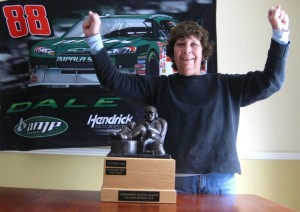 Carol with her fantasy NASCAR trophy