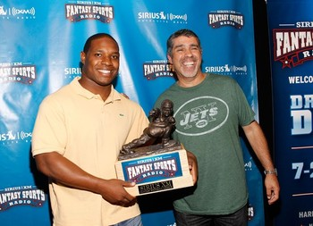 Maurice Jones-Drew and Gary Dell'Abate with the Throwback fantasy football trophy