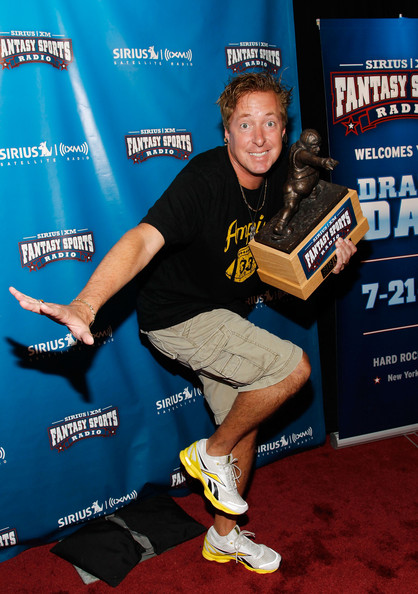 Sirius XM personality Scott Farrell with the Throwback fantasy football trophy